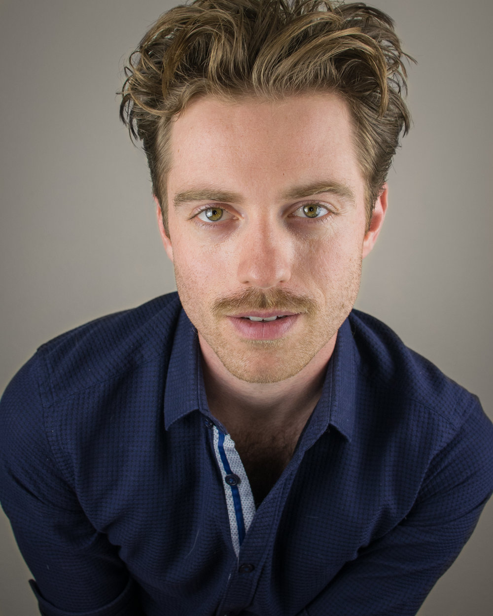 Alex Nee mustache headshot-3.jpg