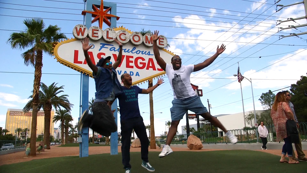 Anthony and friends jumping in front of Las Vegas sign (1).jpg