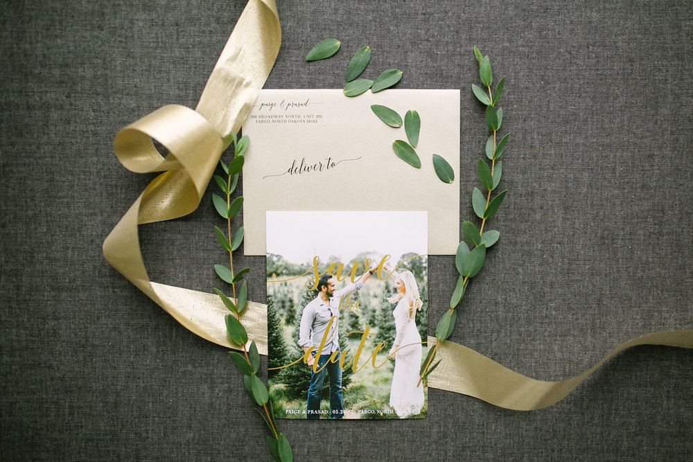 Gold script across a candid picture lends a elegant but carefree vibe to these beautiful save the dates!