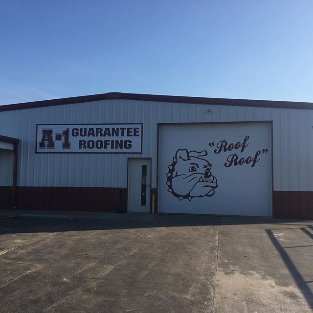 Wrapped a bay door.  Second one we have done.  Great way to draw attention to your store front.  That bull dog is 8' tall.  #wrap #417spots #bulldogs #roof