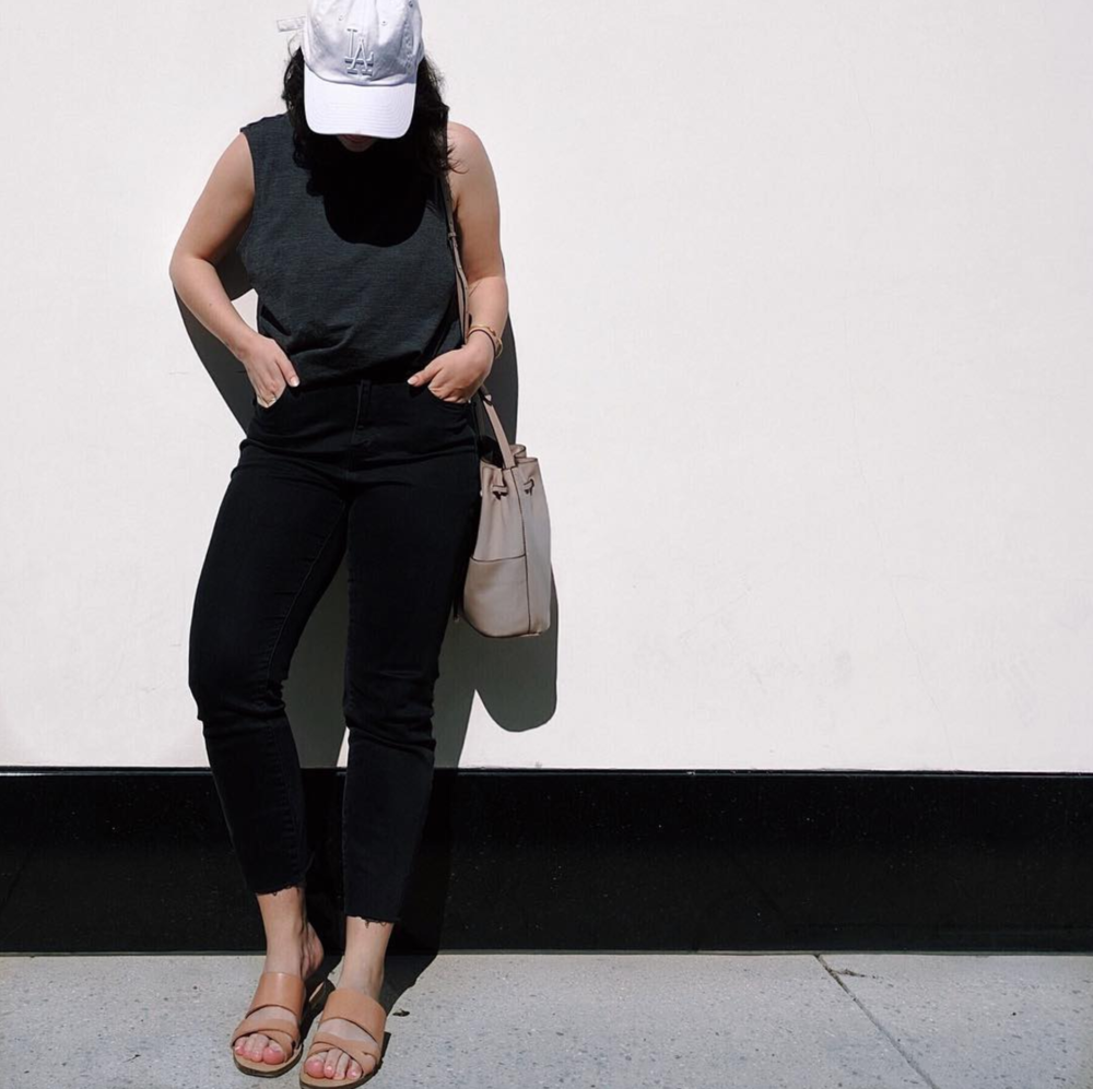 What I'm Wearing: American Needle Cap, Outdoor Voices Muscle Tank, Cuyana Bucket Bag, Madewell High-Waisted Jeans, J.Crew Slides. See below for similar styles.