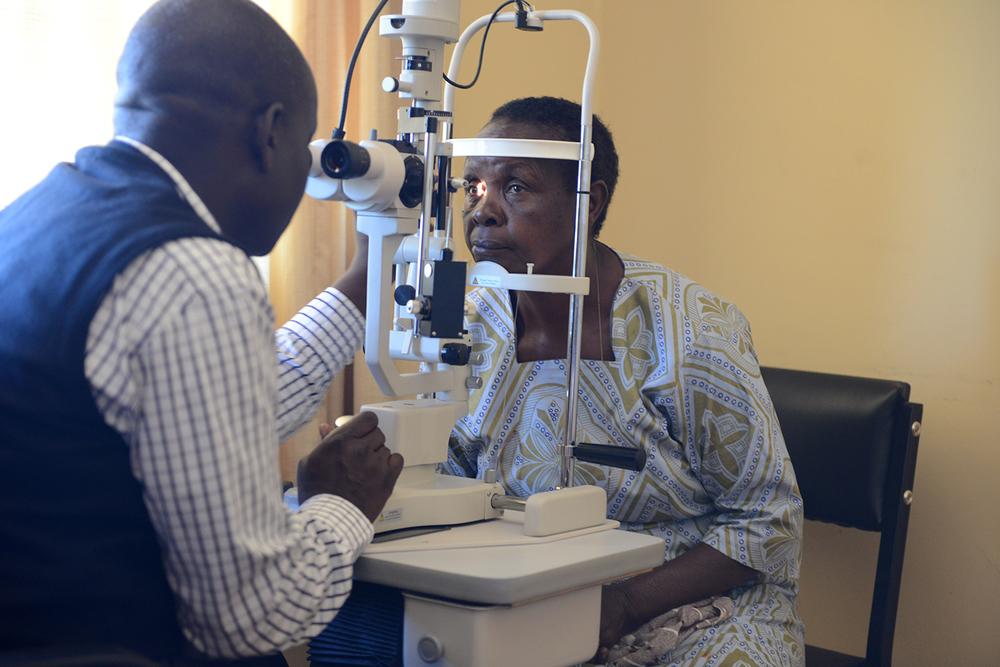 Dr. Kiage examining a patient.