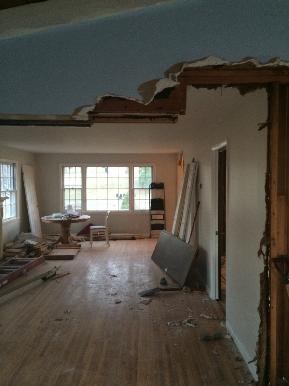 This photo was taken in the midst of opening up the pocket door entry into the living room!