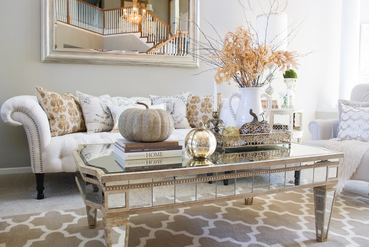 One thing I love to add to my coffee table is coffee table books! They can  add height, texture, and can be a perfect pedestal for a sparkly gold  pumpkin :) - Post — Styled With Lace