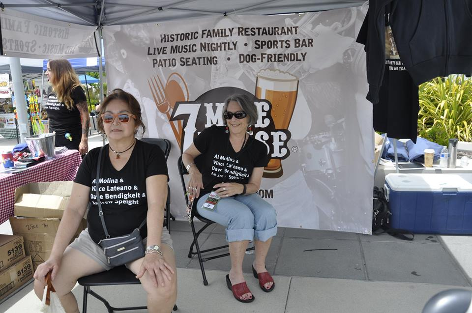 Witnessing at the 7 Mile booth are (from left) Liz Rivas, Cleo Garcia, and Jessica Levant.