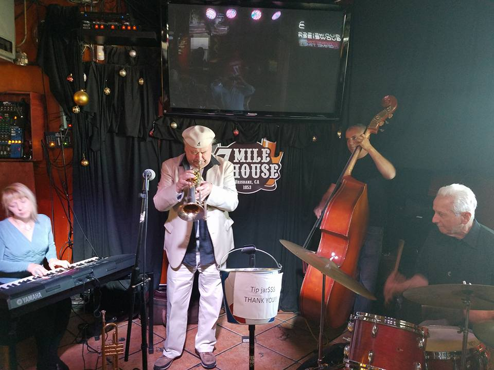 Gaea Schell, Al Molina, Michael Zisman, and Vince Lateano ladle the Doghouse Pre-Labor Day Jam (photo by Jeff Kaliss)