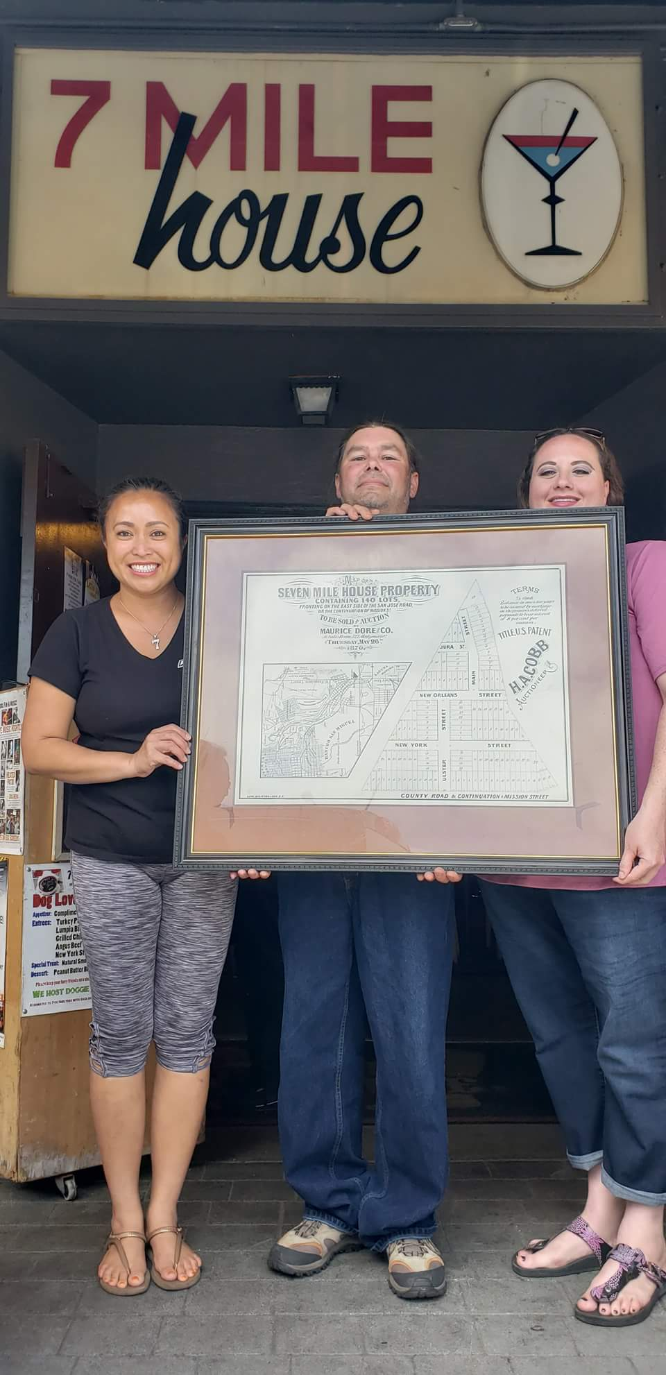 Stephen and Rose Salazar present Vanessa Garcia with antique map from 1870 of the '7 Mile House Property' on Old Mission Road.