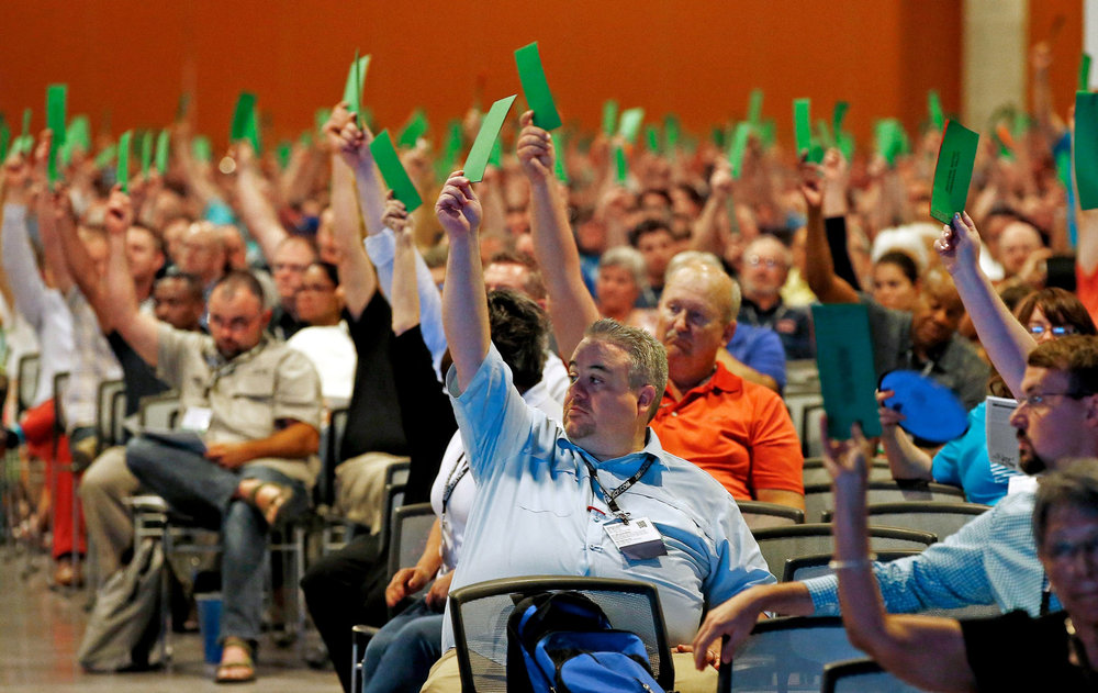 "Southern Baptists voting to formally condemn the political movement known as the ""alt-right,"" at their national meeting in Phoenix in June. Credit: Ross D. Franklin/Associated Press"