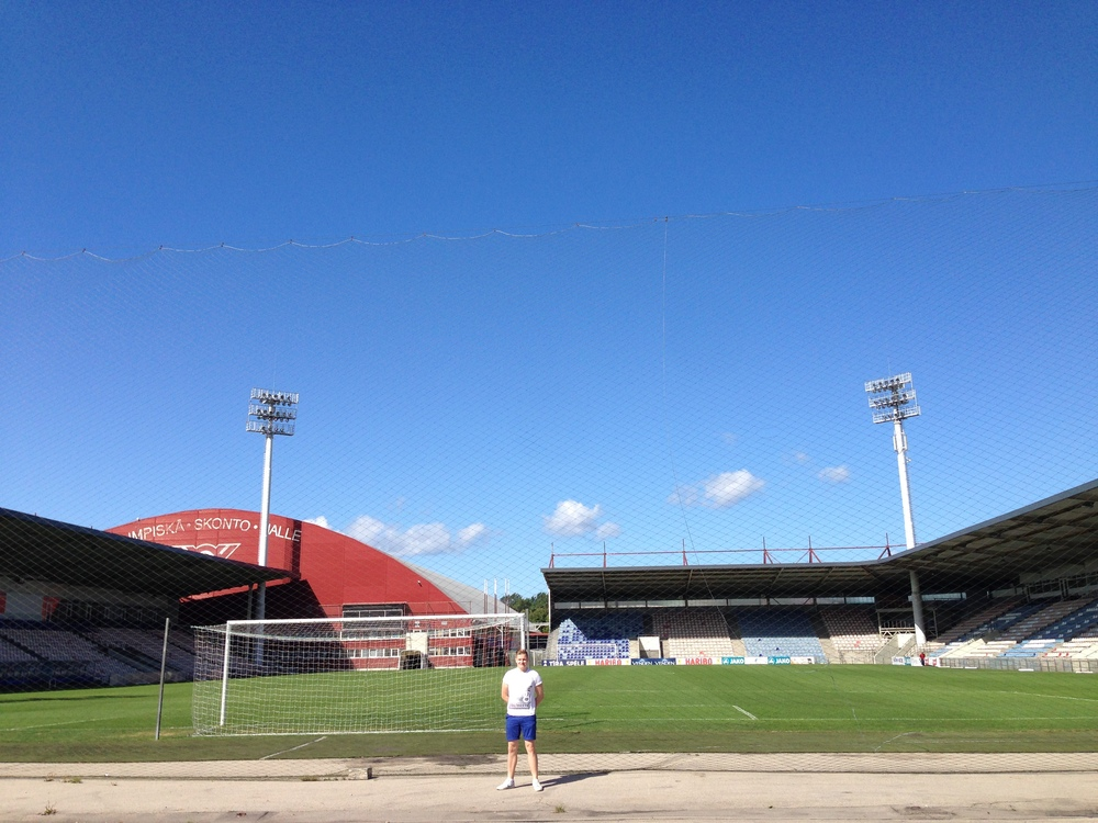 Clearly visible is the absence of one of Skonto Stadium's stands. Between me and the grass in thin netting, which could easily be walked around or crawled under. The training facility can be seen in the top left of the stadium.