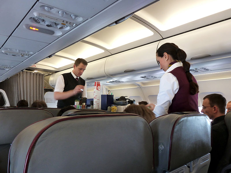 Two flight attendants for Germanwings performing one of their in-flight tasks. Image credit: Oxfordian Kissuth/Wikimedia Commons