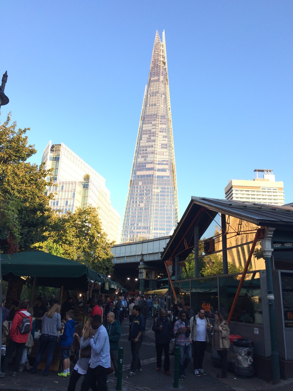 The towering Shard as seen from Borough Market on a sunny London day.