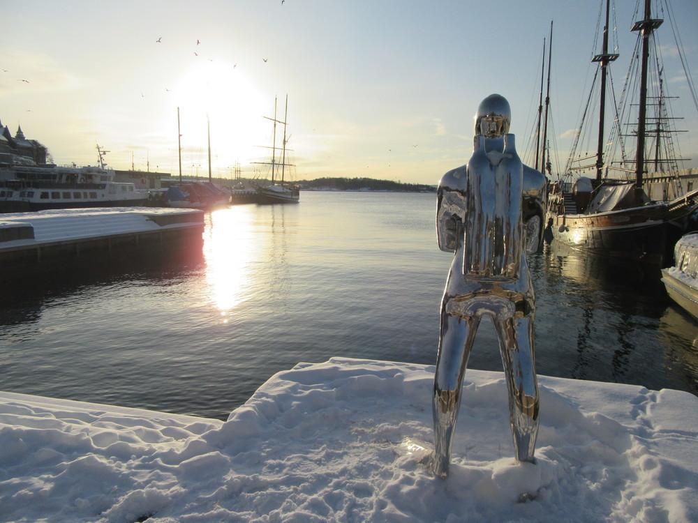 Oslo-Harbour-Statue-Snow-Sun-Norway