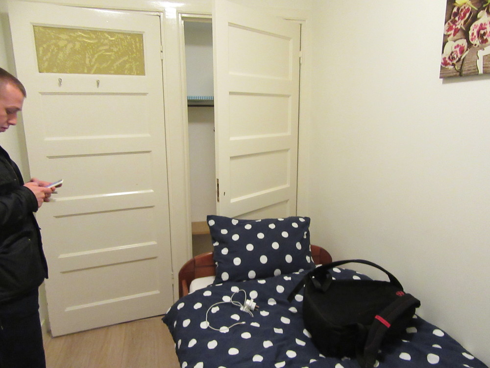 The cupboard behind the pillow was a space for storing clothes.
