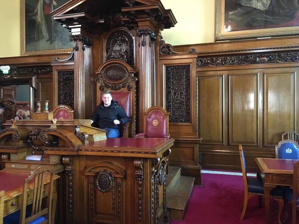 Taking my seat at Belfast City Hall.
