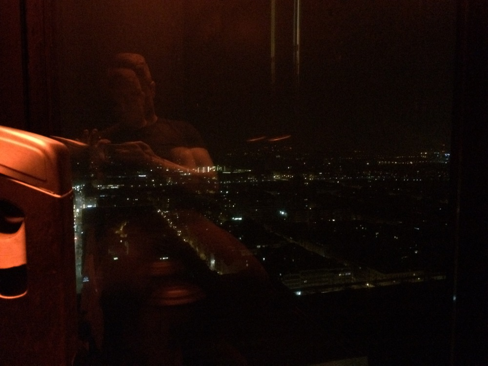 Taking a picture of the view from the toilet seat in Basel's Bar Rouge.