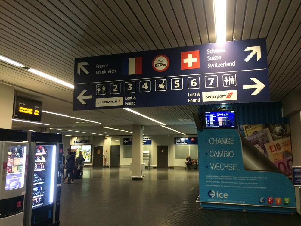 Signage at EuroAirport which has a French sector and a Swiss sector.