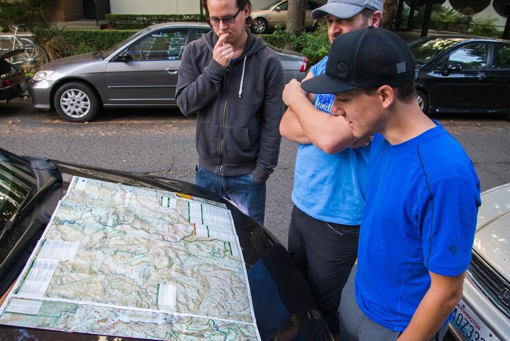 Map-Reading-Car-Bonnet-Travel