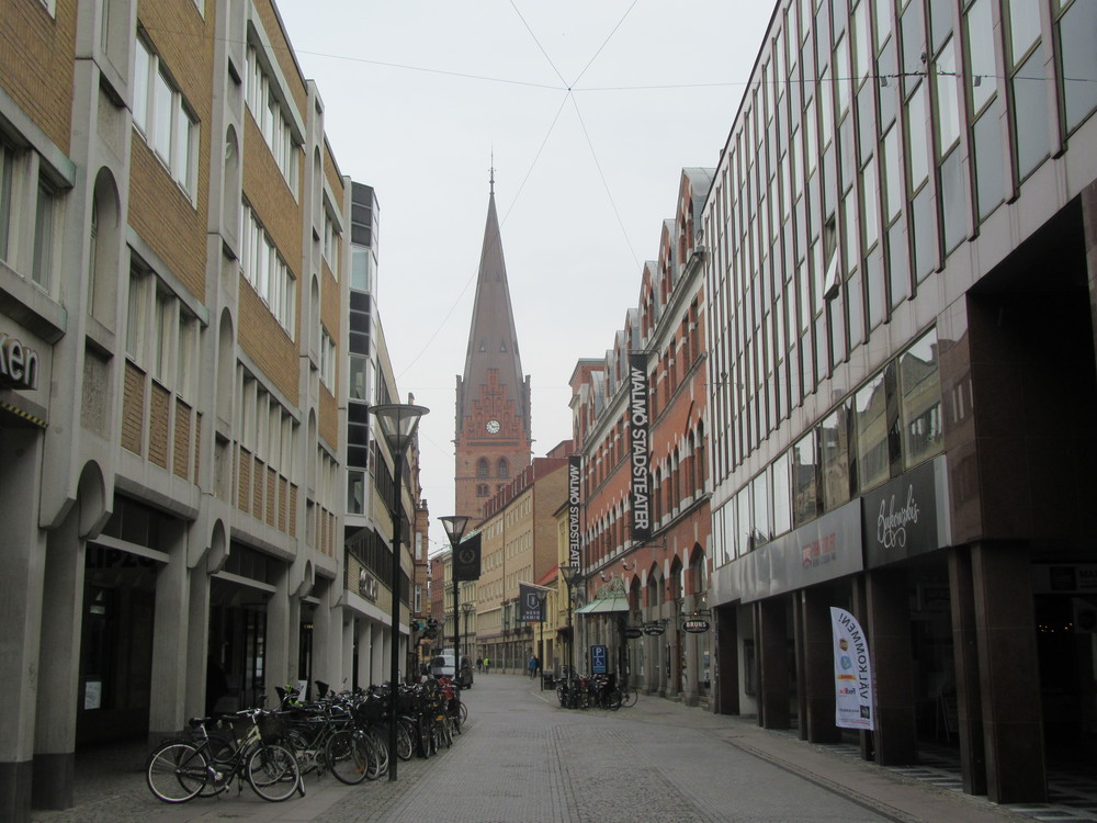 St Peter's Church looks over one of Malmö's streets.