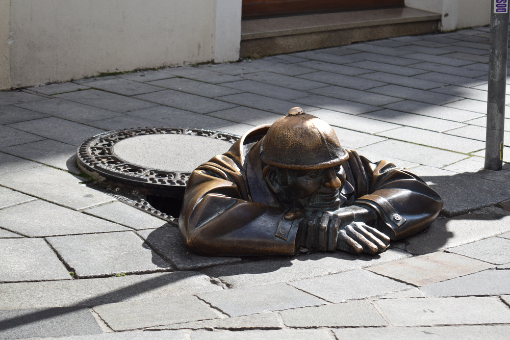 Cumil the Sewer Worker is a statue and symbol in Bratislava. He's said to be either resting after a hard day's work, or pausing to look up women's skirts!
