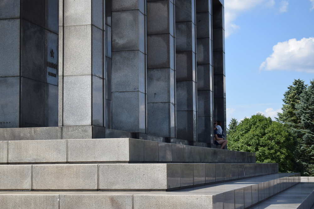 Caught out: a couple getting intimate on a World War II memorial - hardly an appropriate thing to do.