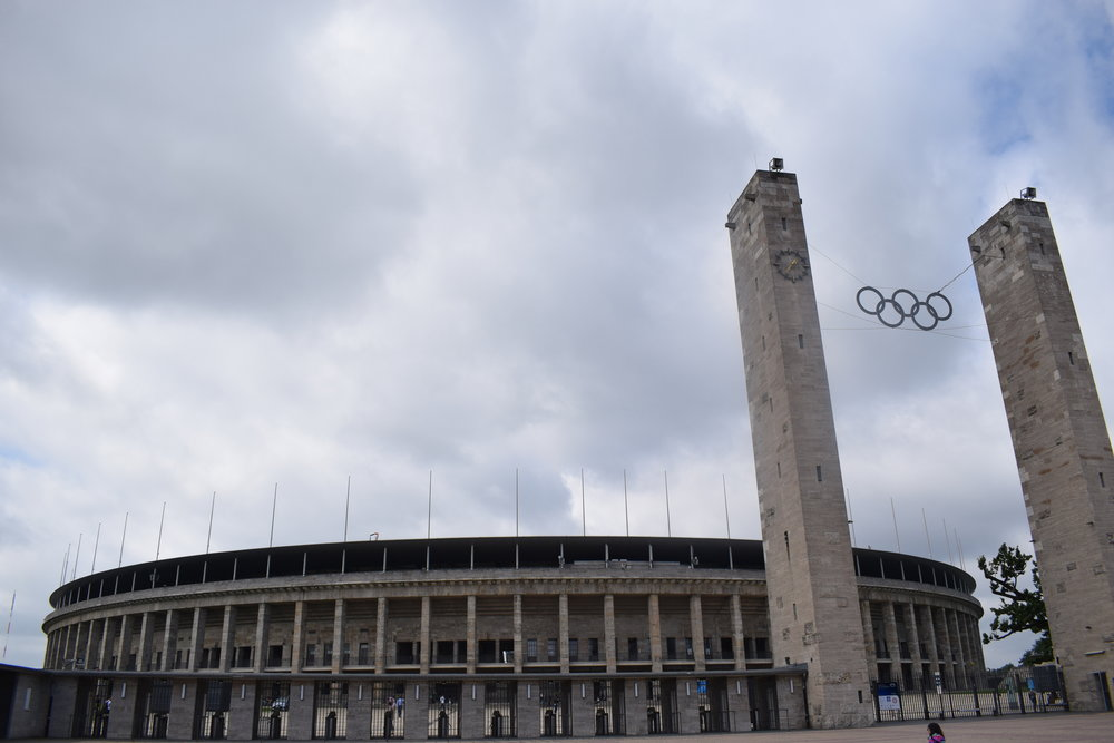 The Olympiastadion still bares the Olympic rings, as well as a troubled past.