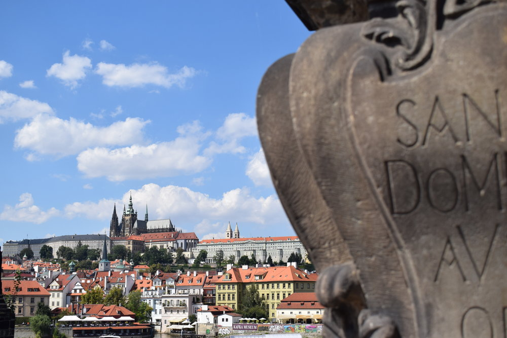 Sneaking a peak at Prague Castle from the Charles Bridge tower.