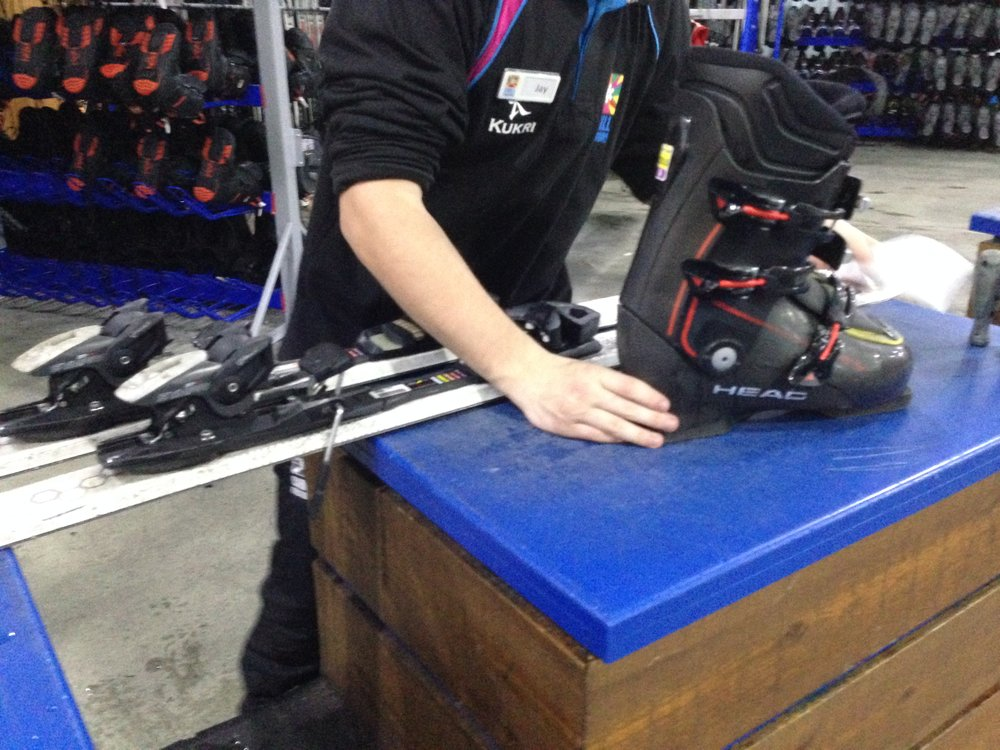 Adjusting the skis to fit my boots.