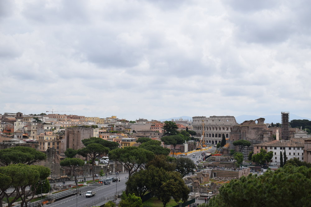 Soaking in views of the Colosseum and the Roman Forum from a vantage point at Altare della Patria.
