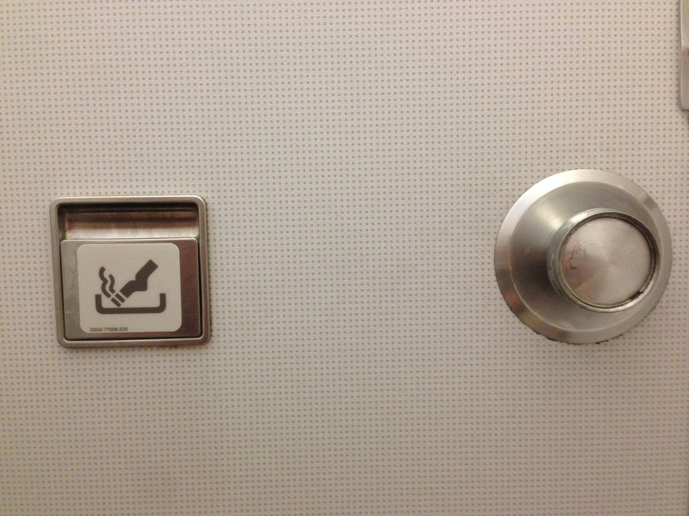 The ashtray inside the toilet door on a Thomas Cook flight.