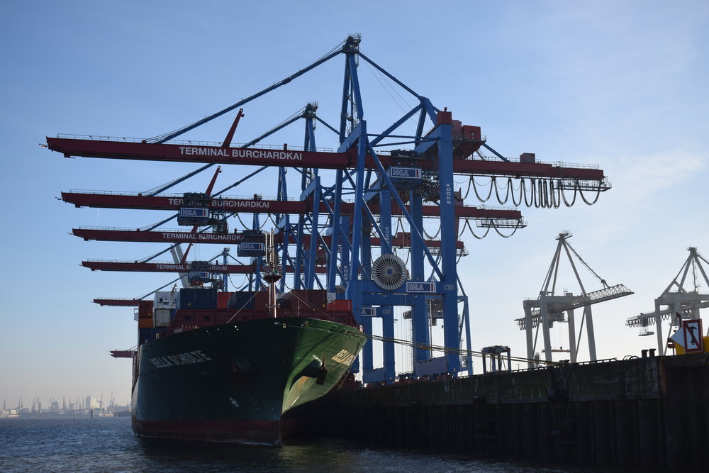 A cargo ship being loaded up at Hamburg port.