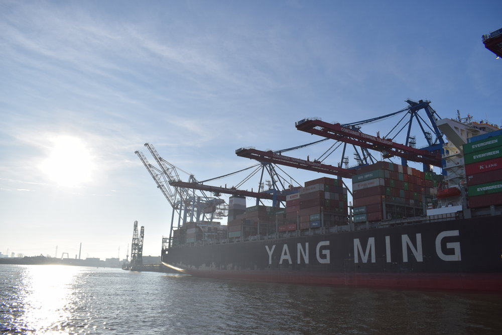 A beautiful look at the sun beating down on the Port of Hamburg and the River Elbe.