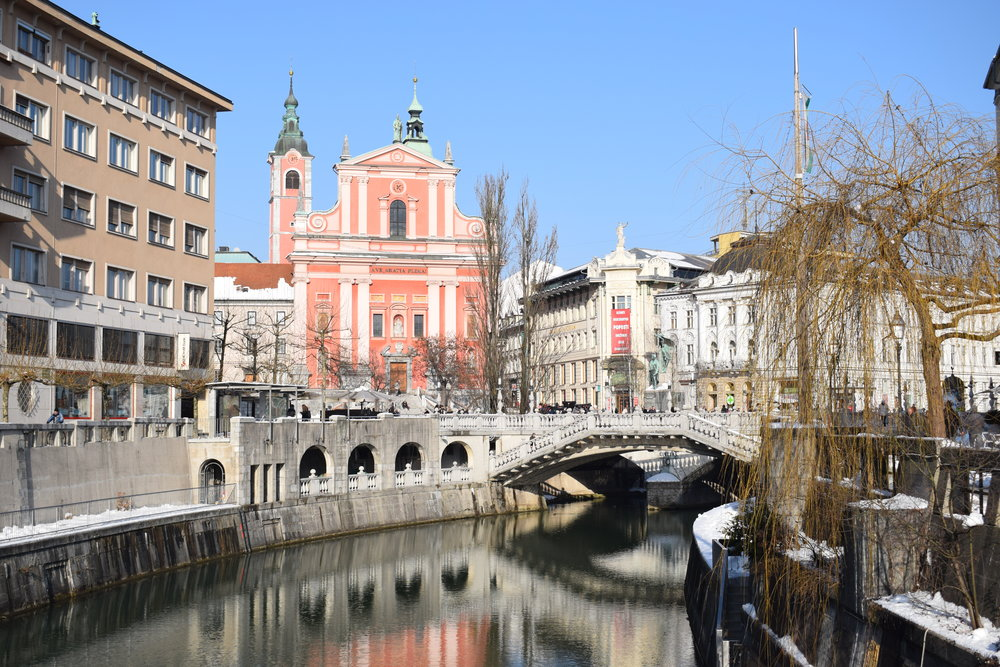 Looking down the Ljubljanica towards the Triple Bridge and the Franciscan Church.