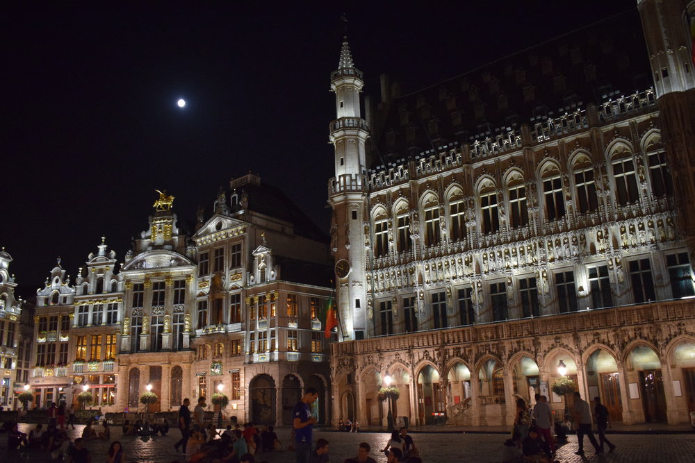 Grand-Place is a popular spot at night with people who sit on the square's cobbles.