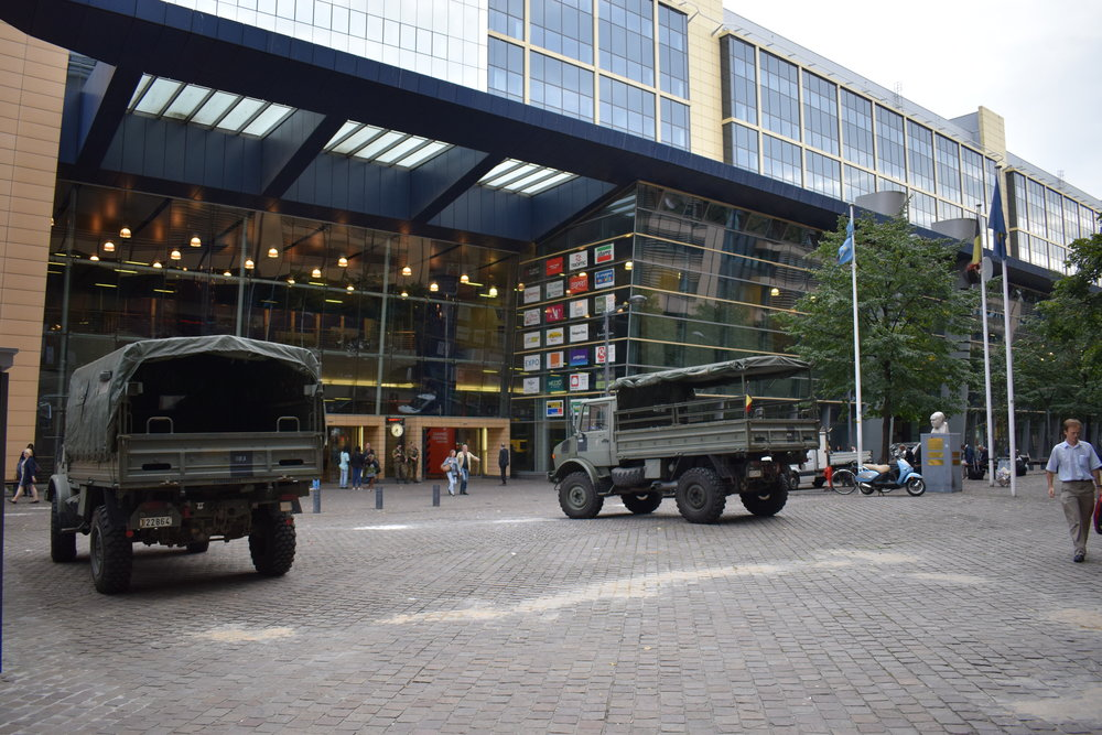 Army wagons stationed outside Brussels-North train station.