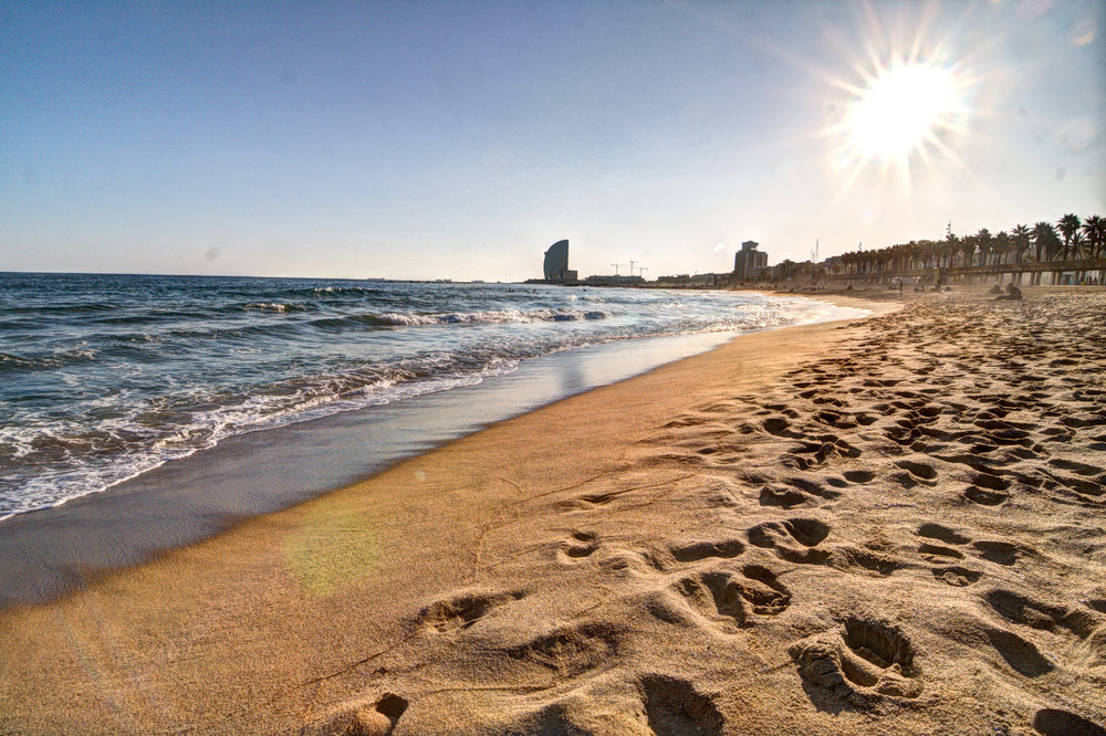 Barcelona beach basking in the Spanish sunshine. Image credit:    annaspies   /   Flickr