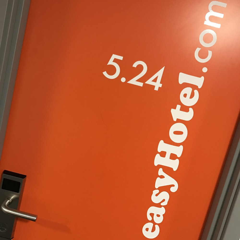 A hotel room door at easyHotel Croydon.