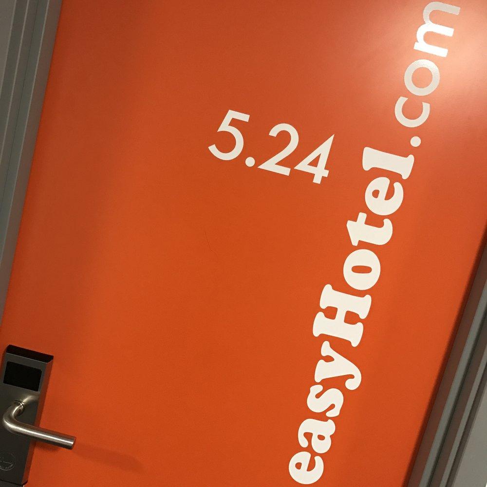 A hotel room door at easyHotel Croydon.