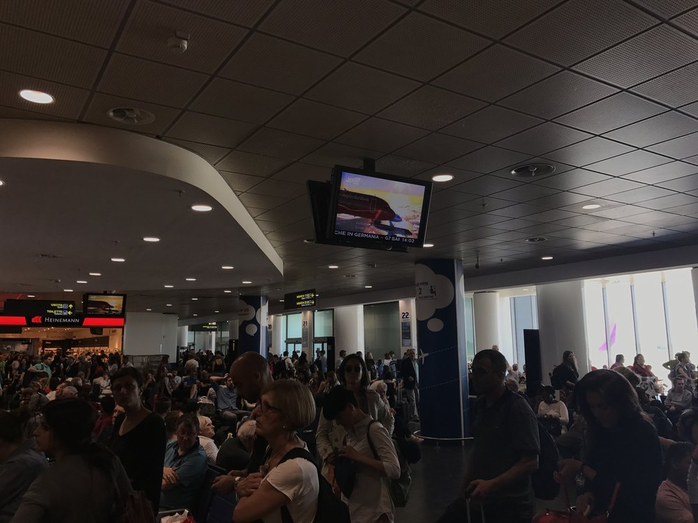 Inside an overcrowded Bologna Guglielmo Marconi Airport.