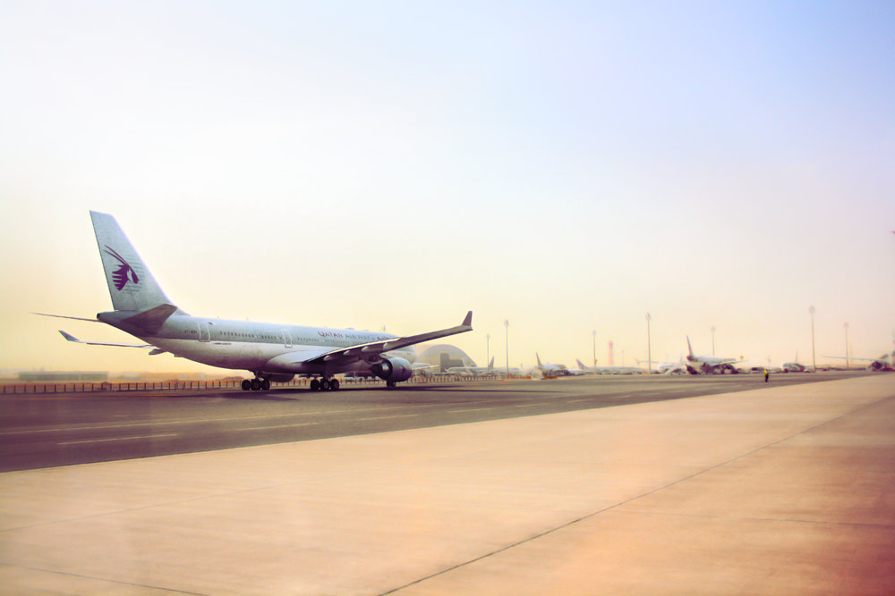 A Qatar Airways flight on the ground at Doha Airport. Image credit: Juanedc/Flickr