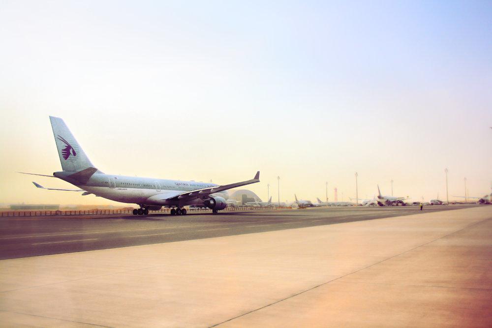 A Qatar Airways flight on the ground at Doha Airport. Image credit:    Juanedc   /   Flickr
