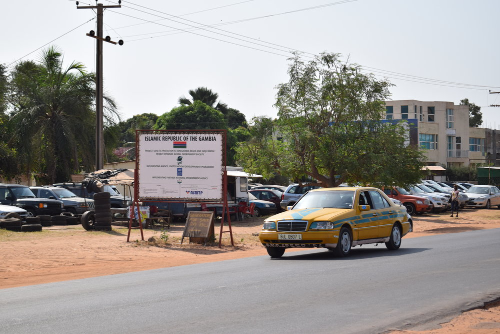 The cool-looking yellow bush taxis are the way to go in The Gambia.