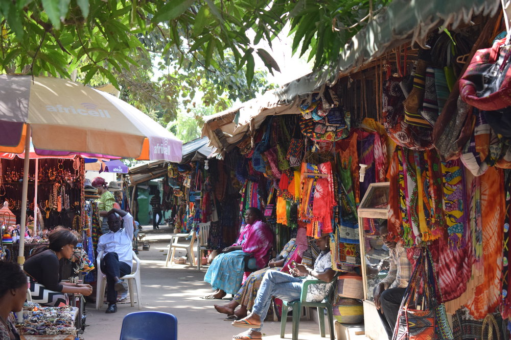 Visiting markets, like this one on the Senegambia Strip, is a great way to spend some time in The Gambia and an opportunity to snag some bargain souvenirs.
