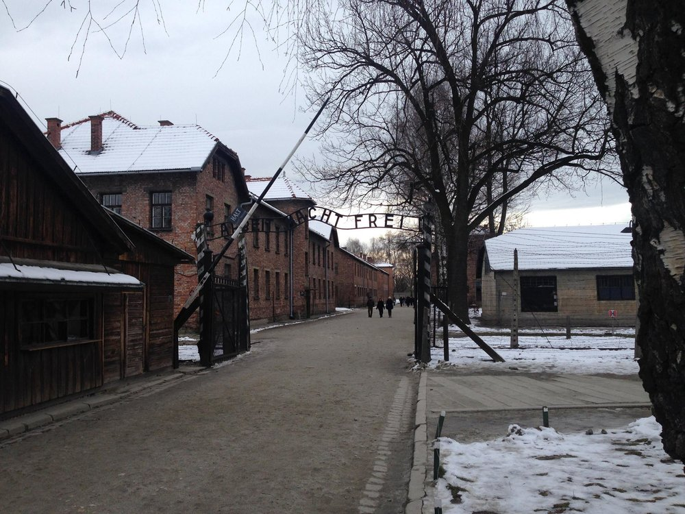 "The famous ""Ahbeit Macht Frei"" sign at the entrance to Auschwitz. This is a replica as the original was stolen, then eventually recovered and is now on display at the Auschwitz-Birkenau State Museum."