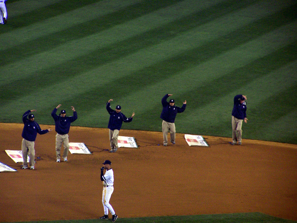 The Yankees' grounds crew dancing to YMCA by Village People during the seventh-inning stretch. Image credit:    KOknockout920   /   Wikimedia Commons