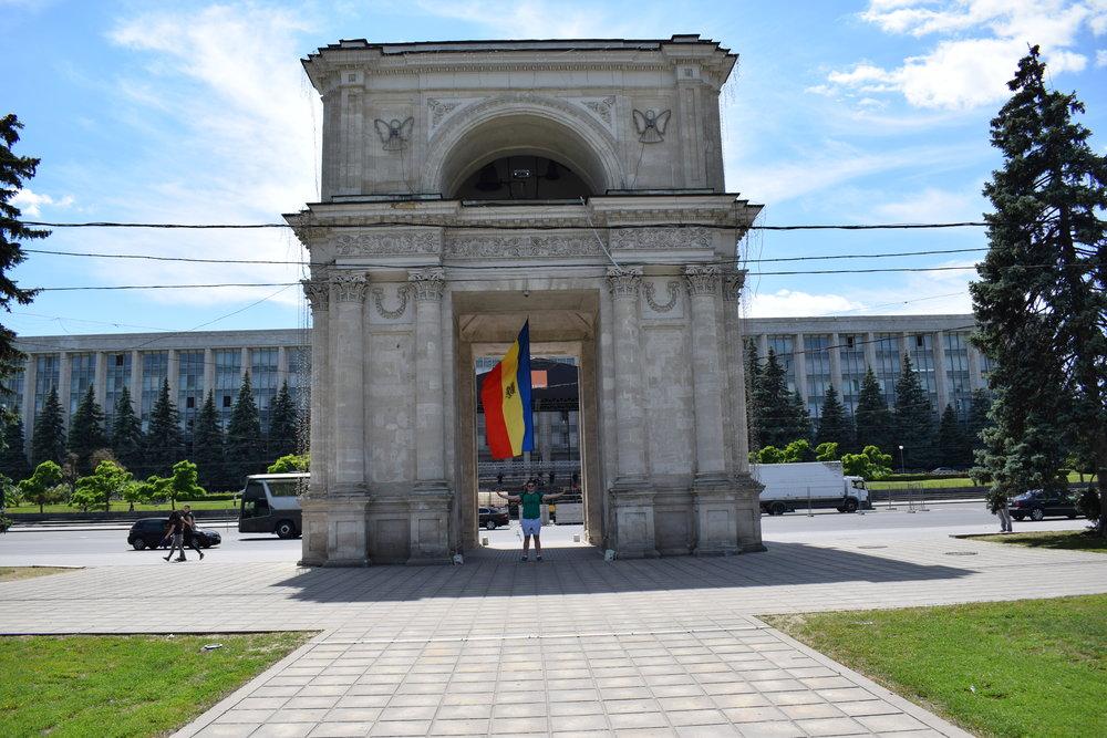 Standing beneath the Triumphal Arch in Chisinau, Moldova.