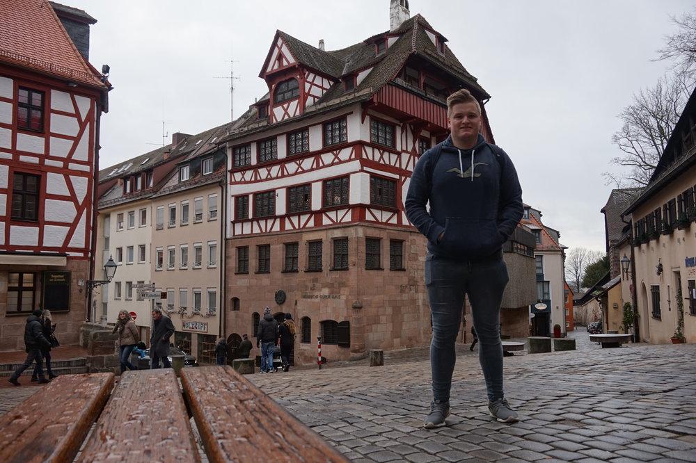 Standing outside the former house of Albrecht Dürer.