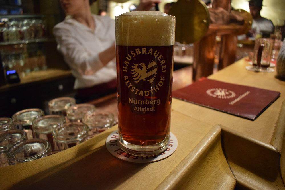 A half-litre of red beer from    Hausbrauerei Altstadhof   .