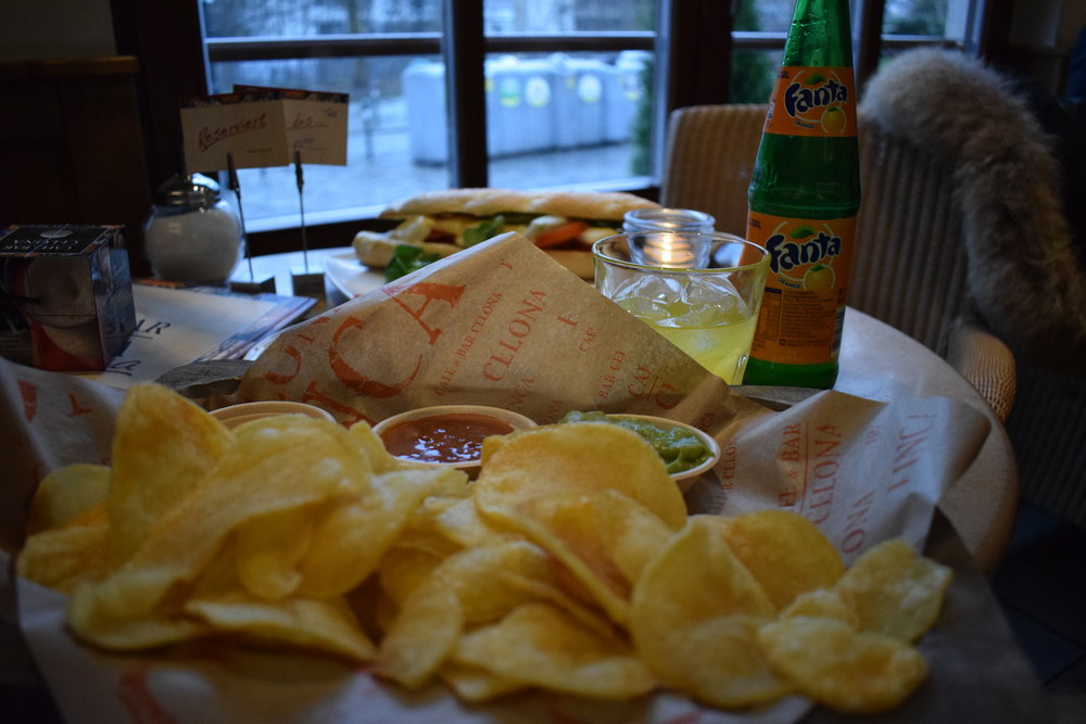 Fresh ly-made potato chips and a bottle of Fanta - which actually originated in Germany - at  Café& Bar Celona .