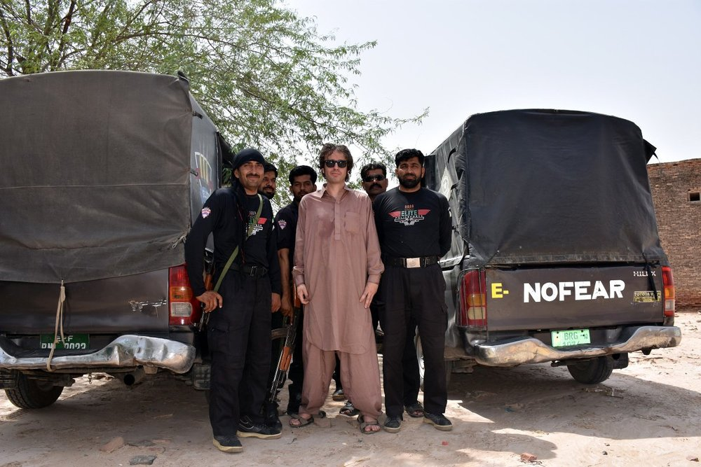 And taking pictures with armed guards in Pakistan. Image credit:    Dylan Harris   /   Twitter