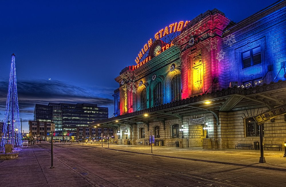 Union Station, Denver's main transportation hub, illuminated in colour. Image credit:  Andy Smith / Creative Commons